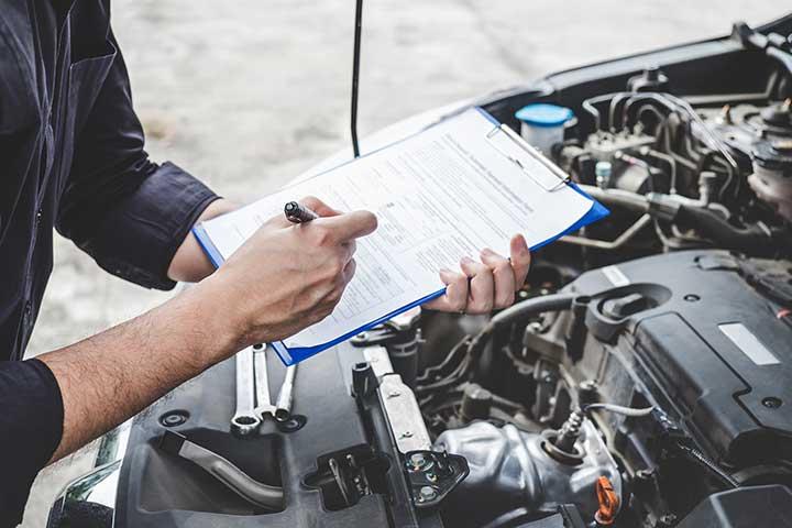 Car Mechanic Inspecting Car