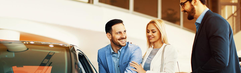 Car Salesman assisting clients