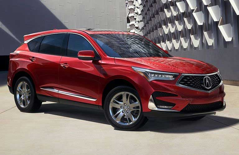 Front passenger angle of a red 2019 Acura RDX