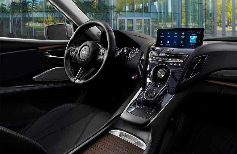 Steering wheel and touchscreen inside the 2019 Acura RDX