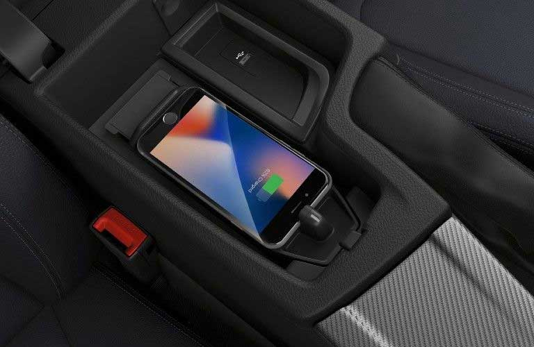 Close up of a phone getting charged in the 2020 BMW 4 Series
