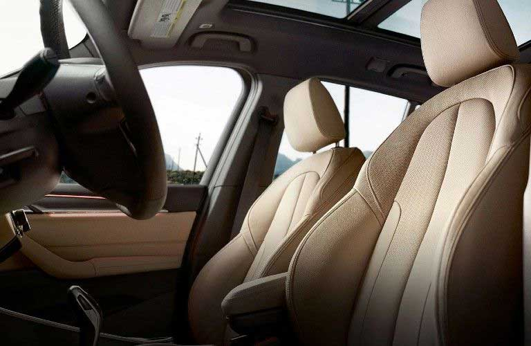 Close up of the front row seats and steering wheel inside the 2020 BMW X1