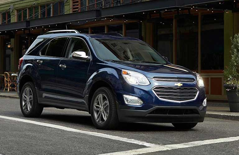 2017 Chevrolet Equinox stopped at a cross walk as someone crosses