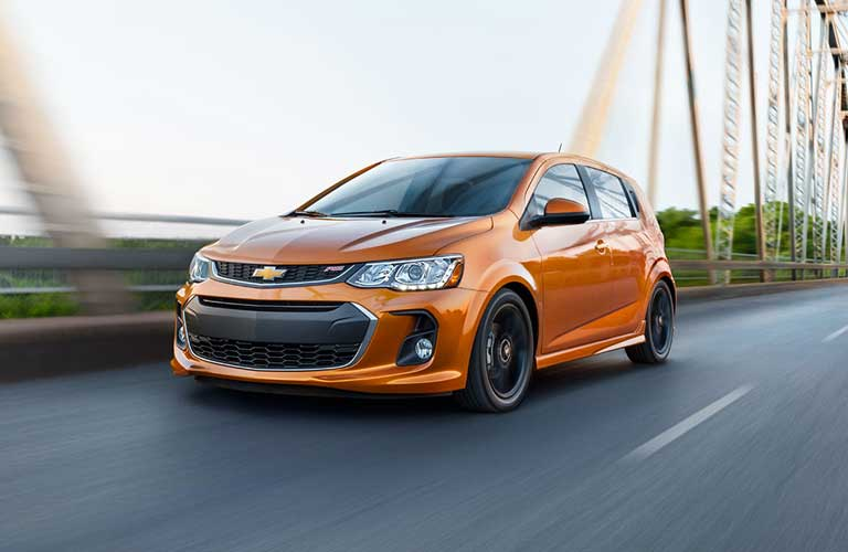 Chevrolet Sonic hatchback driving on a road