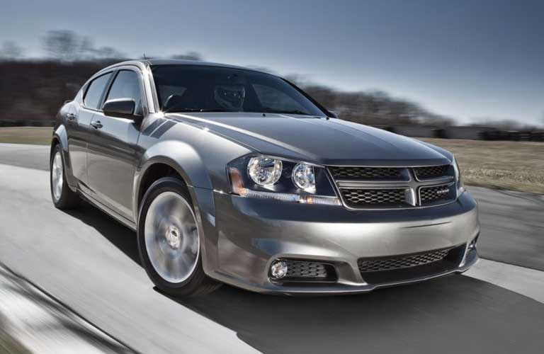 Dodge Avenger driving on a road