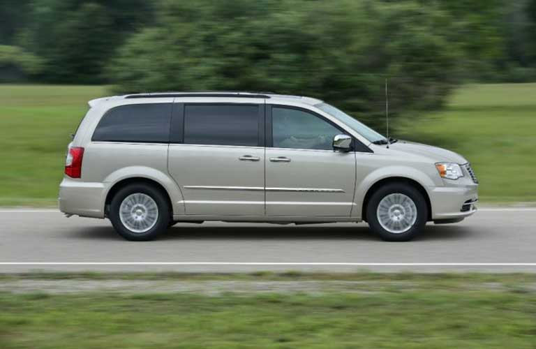 Chrysler Town & Country driving on a road