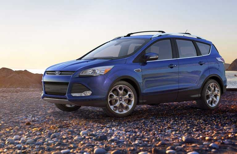 2016 Ford Escape parked on a beach of rocks