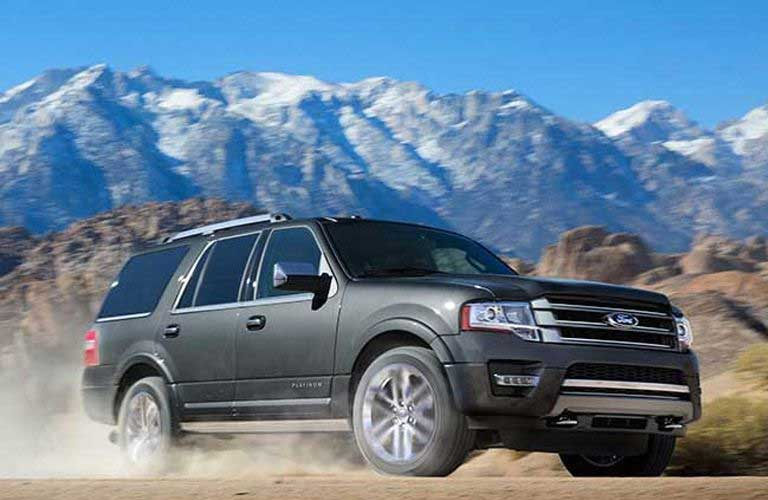 Ford Expedition driving on a dirt trail