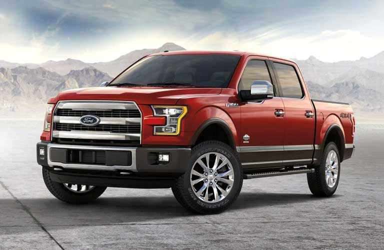 2017 Ford F-150 driver's side profile parked in front of a mountain range