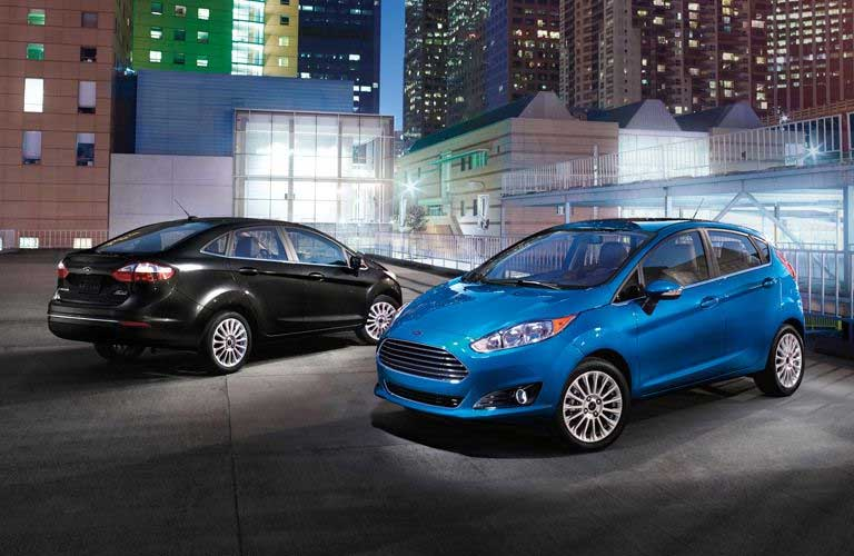 Used Ford Fiesta sedan and hatchback parked in a lot