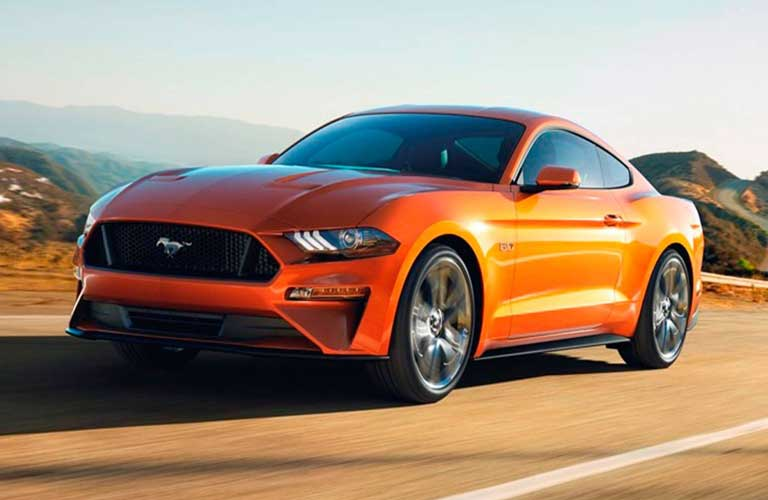 Ford Mustang driving on a highway