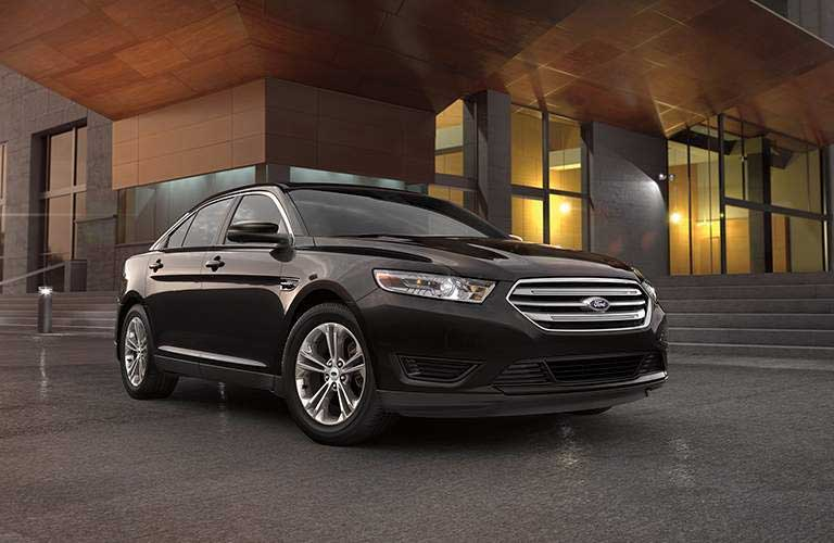 Ford Taurus parked in front of a building