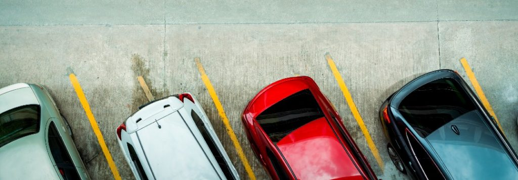 Aerial angle of cars parked in a parking lot
