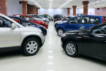 Cars parked inside a car dealership