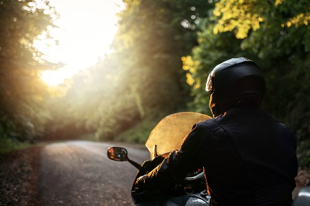 Rear angle of a person driving a motorcycle