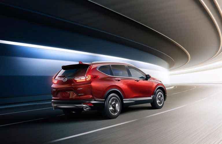 2017 Honda CR-V driving quickly through a tunnel around a curve
