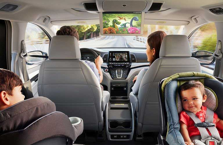 Honda Odyssey interior with parents and children seated
