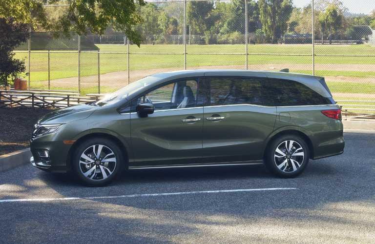 Honda Odyssey parked by baseball field