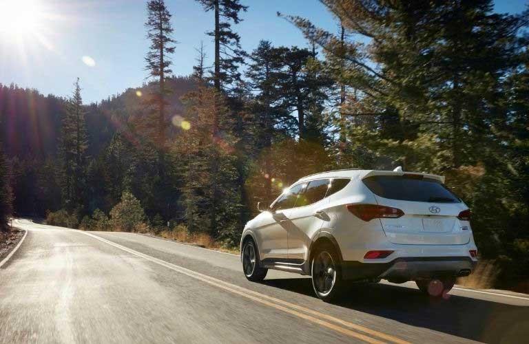 2018 Hyundai Santa Fe Sport driving toward the sun
