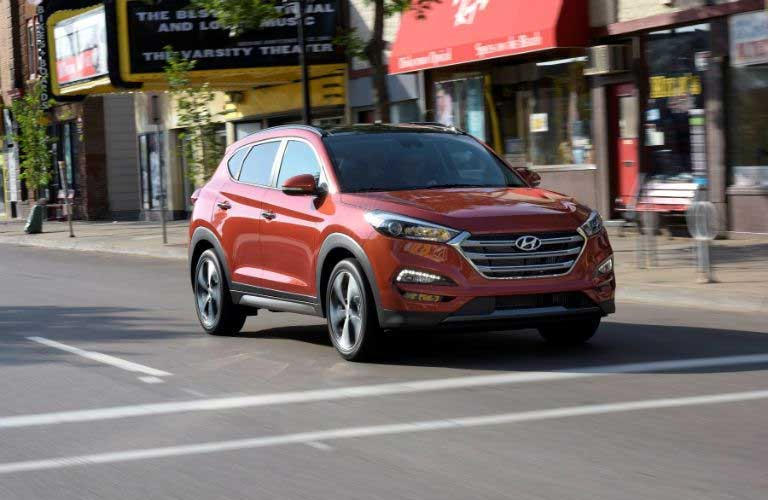 Hyundai Tucson driving on a city street