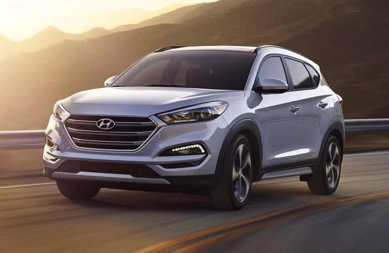 Hyundai Tucson driving on a road