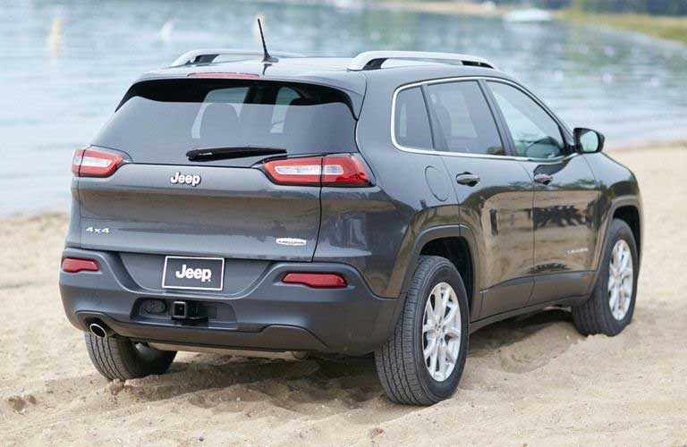 Rear Quarter profile of the 2016 Jeep Cherokee parked by a body of water