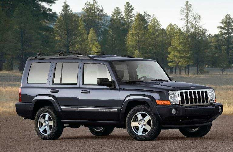 Front passenger angle of a blue 2010 Jeep Commander