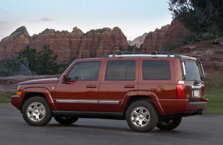 Rear driver angle of a red 2008 Jeep Commander