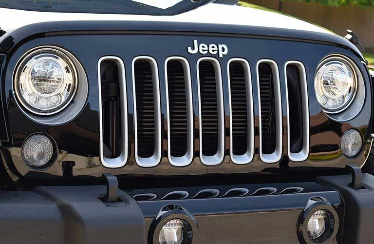 close up on the grille and headlights of the 2017 Jeep Wrangler