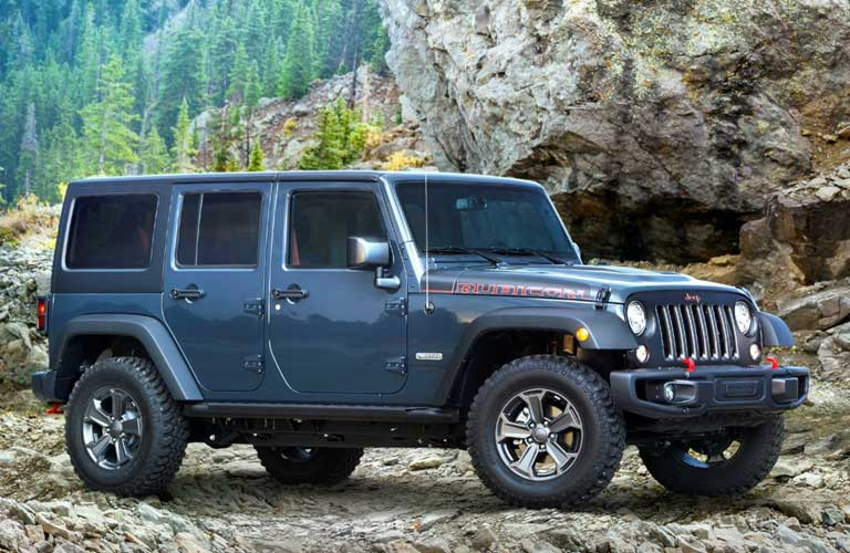 Jeep Wrangler Unlimited parked on rocks