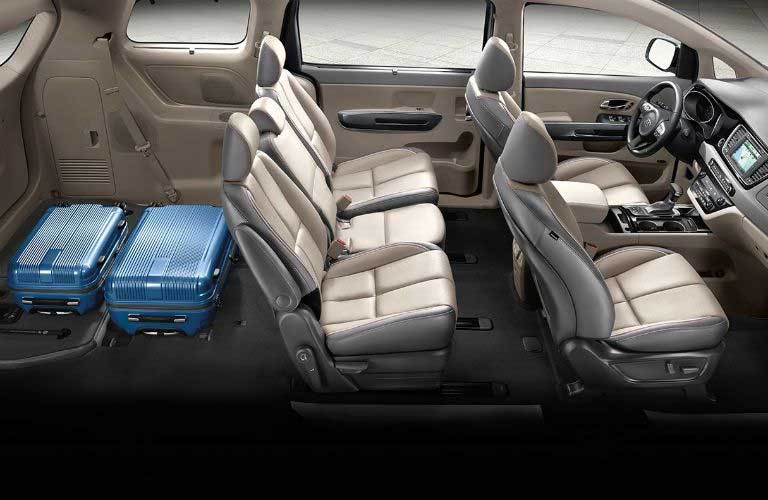 Kia Sedona with third-row seats folded down and luggage in the back