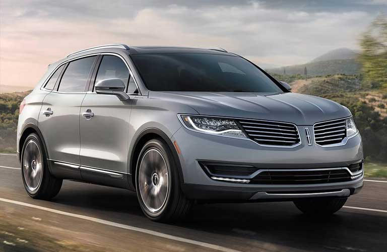 Front passenger angle of a 2017 Lincoln MKX driving on a road