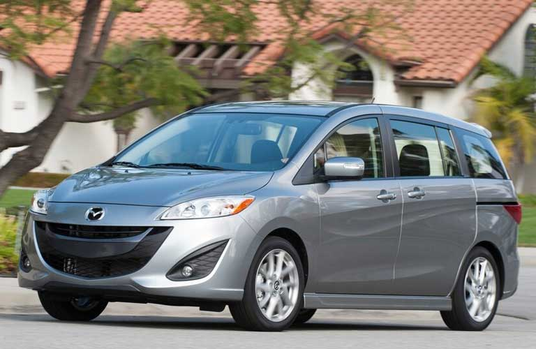 Front driver angle of a silver 2015 Mazda5