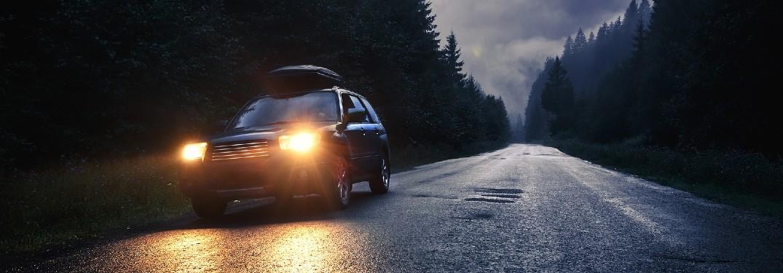 SUV driving at night
