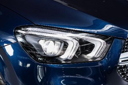 Close up of an LED headlight on a blue car