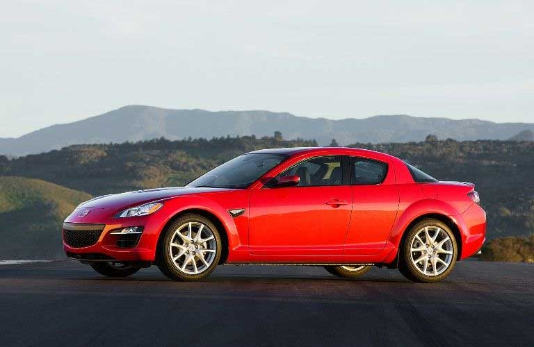 Front driver angle of a red 2009 Mazda RX-8