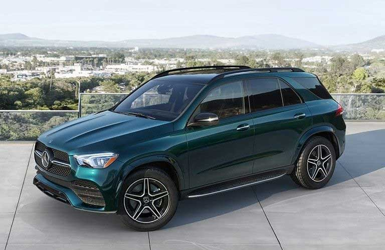 Front driver angle of a green 2021 Mercedes-Benz GLE