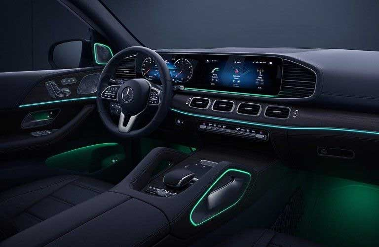 Front interior in the 2021 Mercedes-Benz GLE with green ambient lighting