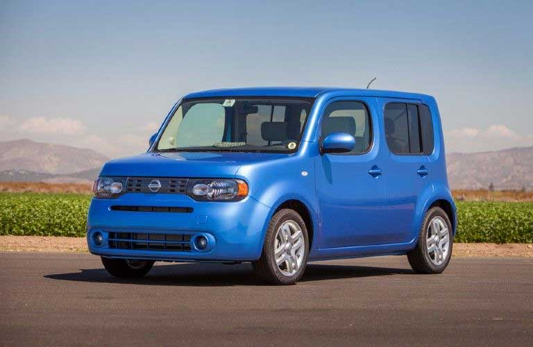 Front driver angle of a blue 2014 Nissan cube
