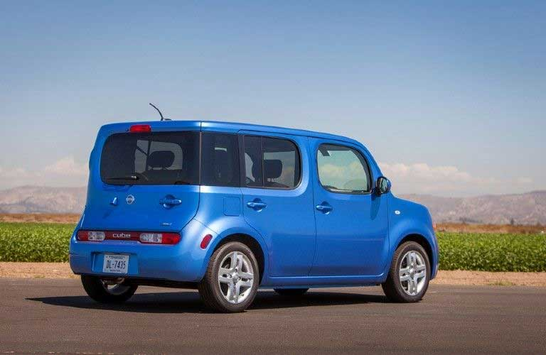 Rear passenger angle of a blue 2014 Nissan cube