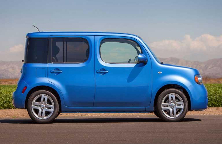 Passenger angle of a blue 2014 Nissan cube