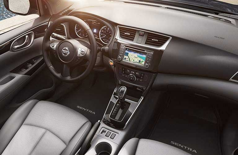 2016 Nissan Sentra interior with focus on steering wheel and console display