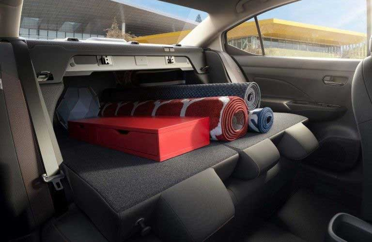 Rear seats in the 2020 Nissan Versa folded down with cargo loaded inside
