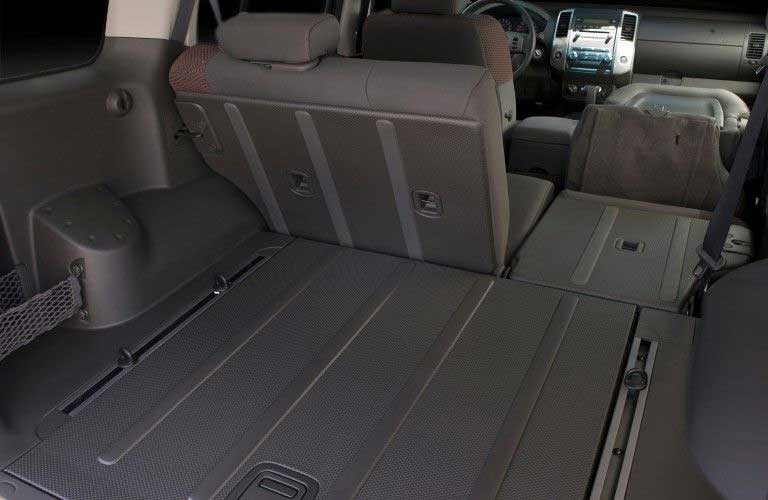 Cargo space inside the 2009 Nissan Xterra with one of the seats folded