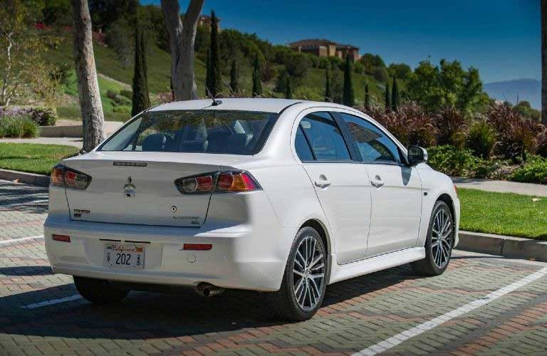 Rear passenger angle of a white 2017 Mitsubishi Lancer