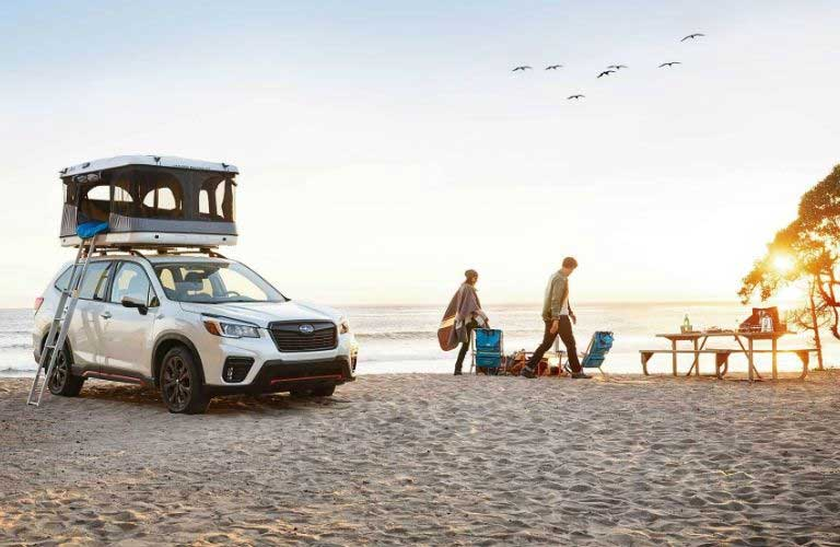 Subaru Forester parked on a beach