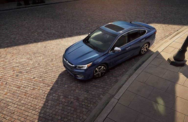 Front driver angle of a blue 2020 Subaru Legacy