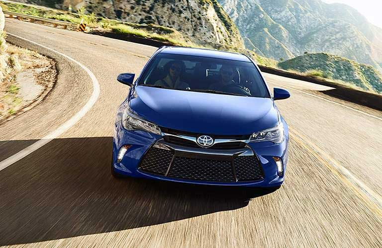 2016 Toyota Camry driving around a curvy mountain road