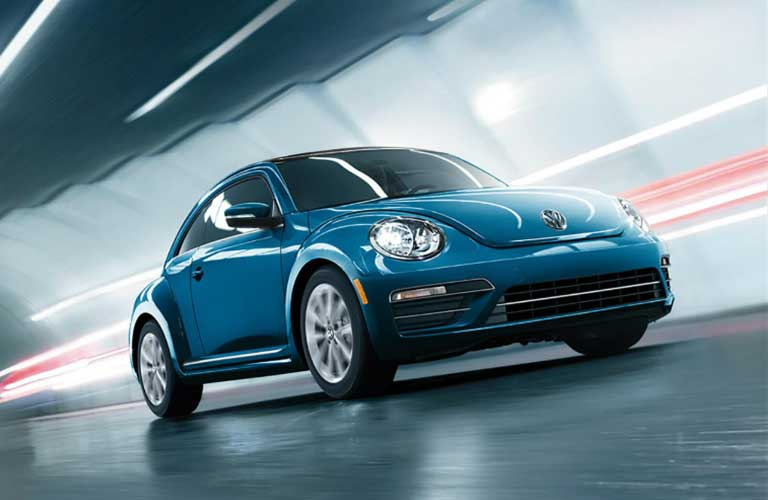 2017 Volkswagen Beetle driving through a tunnel