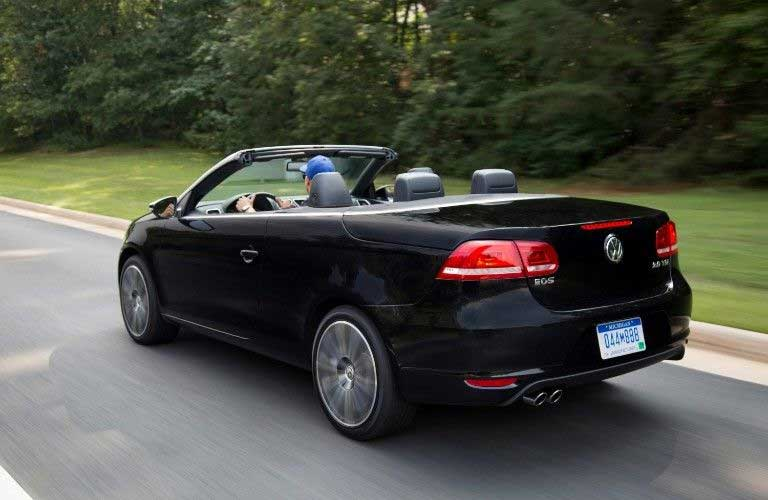 Rear driver angle of a black 2015 Volkswagen Eos convertible